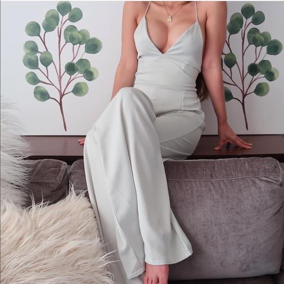 Boohoo Dresses & Skirts - Green satin jumpsuit low cut